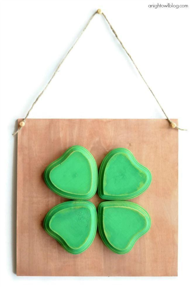 """<p>Hang this homemade four leaf clover sign in your entry hall, on your porch, or anywhere you want to attract some luck.</p><p><strong>Get the tutorial at <a href=""""https://www.anightowlblog.com/diy-four-leaf-clover-sign/"""" rel=""""nofollow noopener"""" target=""""_blank"""" data-ylk=""""slk:A Night Owl"""" class=""""link rapid-noclick-resp"""">A Night Owl</a>.</strong></p><p><a class=""""link rapid-noclick-resp"""" href=""""https://go.redirectingat.com?id=74968X1596630&url=https%3A%2F%2Fwww.walmart.com%2Fsearch%2F%3Fquery%3Dglue%2Bguns&sref=https%3A%2F%2Fwww.thepioneerwoman.com%2Fhome-lifestyle%2Fcrafts-diy%2Fg34931626%2Fst-patricks-day-decorations%2F"""" rel=""""nofollow noopener"""" target=""""_blank"""" data-ylk=""""slk:SHOP GLUE GUNS"""">SHOP GLUE GUNS</a><br></p>"""