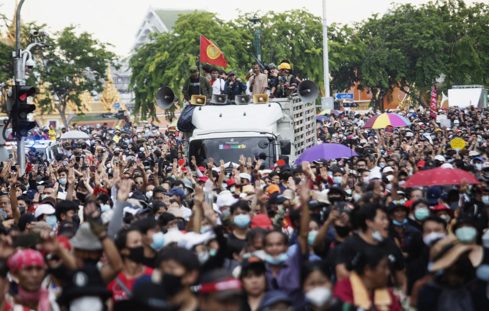 Anti-government protesters march from Democracy Monument to government house in Bangkok, Thailand, Wednesday, Oct. 14, 2020. Anti-government protesters began gathering Wednesday for a planned rally at Bangkok's Democracy Monument being held on the anniversary of a 1973 popular uprising that led to the ousting of a military dictatorship, amid a heavy police presence and fear of clashes with political opponents. (AP Photo/Sakchai Lalit)
