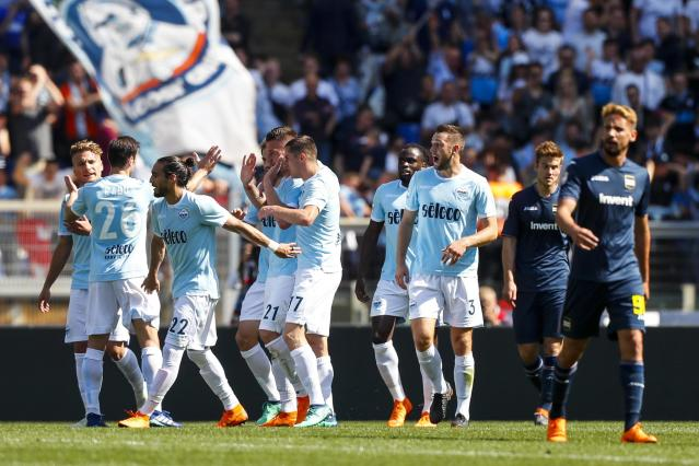 Lazio's Sergej Milinkovic-Savic celebrates with his teammates after scoring during the Serie A soccer match between Lazio and Sampdoria at the Rome Olympic stadium Sunday, April 22, 2018. (Angelo Carconi/ANSA via AP)