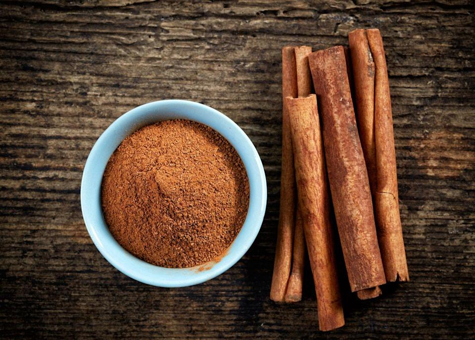 """<p>A sprinkle in your oatmeal, yogurt, or coffee adds a hint of natural sweetness without the need for sugar, but that's not all cinnamon can do. It's been shown to improve blood glucose levels by slowing the absorption of carbs and making it easier for cells to absorb insulin, McKittrick explains. </p><p>And you don't need much: <a href=""""https://www.ncbi.nlm.nih.gov/pubmed/14633804"""" rel=""""nofollow noopener"""" target=""""_blank"""" data-ylk=""""slk:Findings suggest"""" class=""""link rapid-noclick-resp"""">Findings suggest</a> you can reap the benefits by eating just half a teaspoon of cinnamon daily.</p>"""