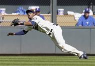 Minnesota Twins center fielder Aaron Hicks dives for a shallow pop fly off the bat of Texas Rangers' A.J. Pierzynski before making the catch in the fourth inning of a baseball game on Saturday, April 27, 2013, in Minneapolis. (AP Photo/Jim Mone)