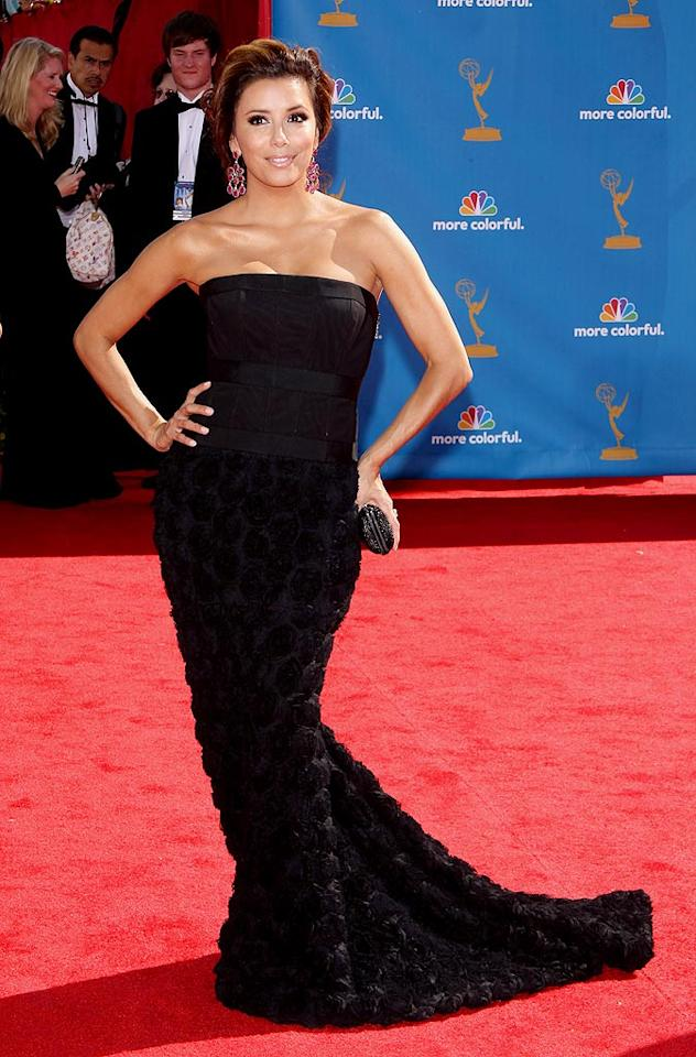 """Eva Longoria Parker<br> Grade: B<br><br> The """"Desperate Housewife"""" played it safe in a textured Robert Rodriguez gown and Loren jewels. Eva doesn't look bad ... just a little boring."""