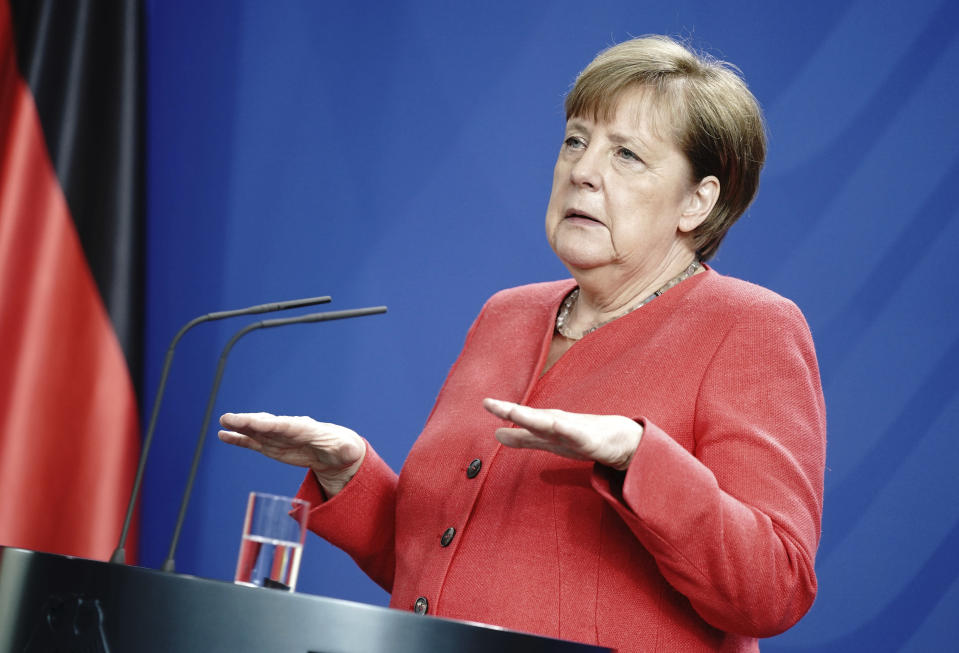 German Chancellor Angela Merkel addresses the media during a press conference in Berlin, Germany, Friday, June 19, 2020 after video meeting with the members of the European Council. (Kay Nietfeld/DPA via AP, Pool)