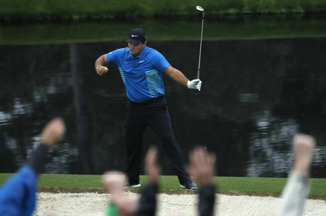 Patrick Reed of the U.S. celebrates chipping in for an eagle on the 15th hole during third round play of the 2018 Masters golf tournament. (Reuters)