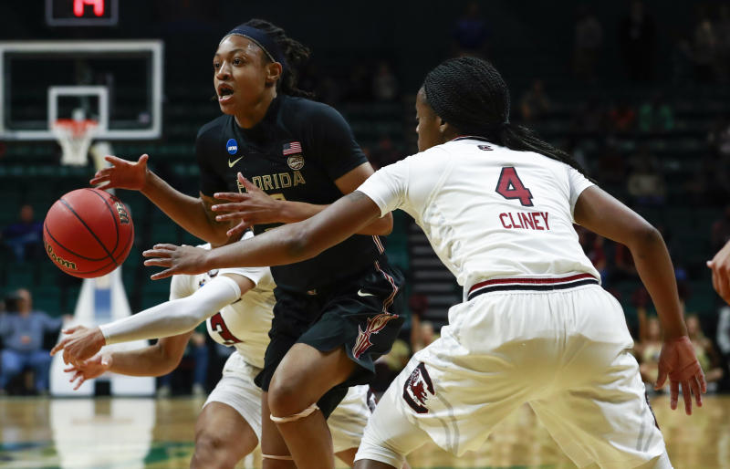 Florida State guard Nicki Ekhomu, front left, tries to pass around South Carolina defender Doniyah Cliney (4) during the first half of a second-round women's college basketball game in the NCAA Tournament in Charlotte, N.C., Sunday, March 24, 2019. (AP Photo/Jason E. Miczek)