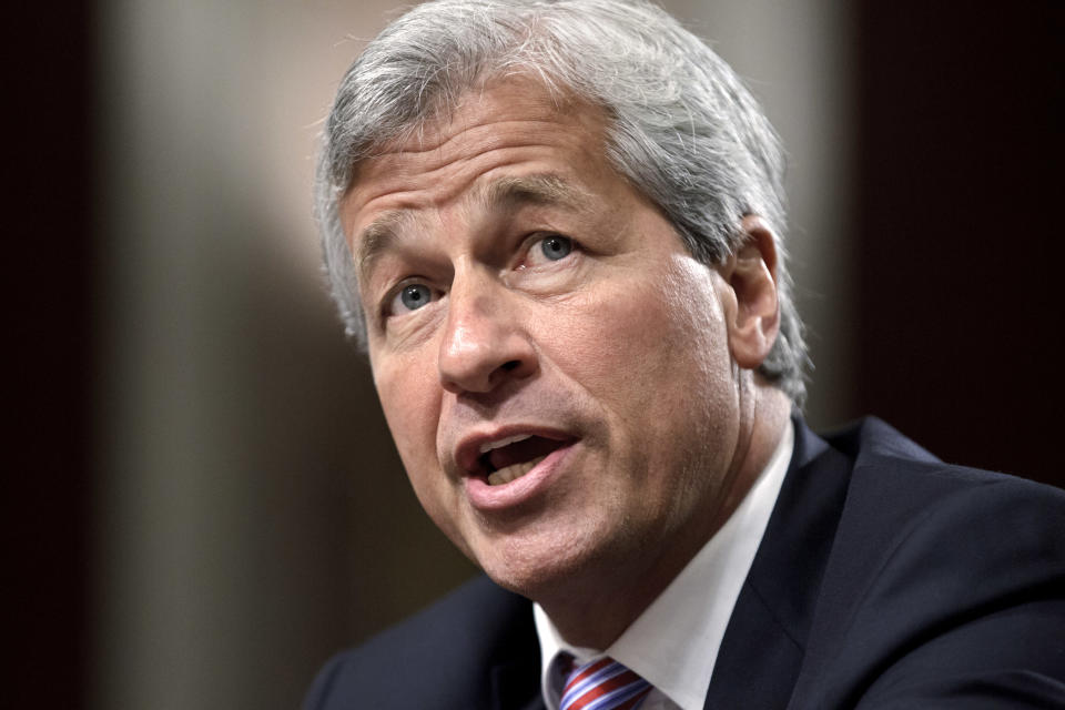 FILE - In this June 13, 2012 file photo, JPMorgan Chase CEO Jamie Dimon testifies before the Senate Banking Committee on Capitol Hill in Washington. Dimon on Tuesday, Oct. 14, 2014 said that more coordination between businesses and government is needed to combat the rising threat of cyberattacks. (AP Photo/J. Scott Applewhite, File)