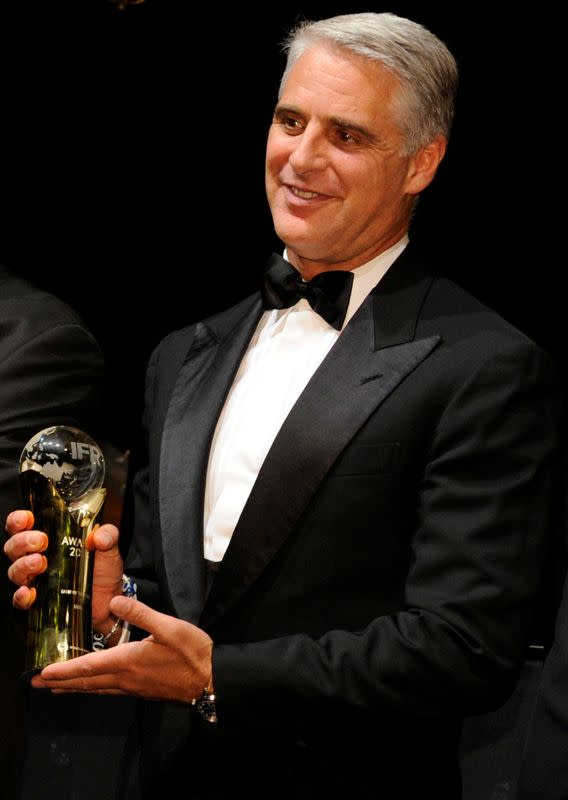 Andrea Orcel poses with an award at the 2016 IFR Awards event in London