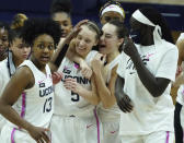 FILE - Connecticut guard Nika Muhl (10) hugs guard Paige Bueckers (5) after defeating South Carolina in overtime of an NCAA college basketball game in Storrs, Conn., in this Monday, Feb. 8, 2021, file photo. UConn has moved up to No. 1 in The Associated Press women's basketball poll, Monday, Feb. 15, 2021, for the first time this season after beating top-ranked South Carolina last week.(David Butler/Pool Photo via AP, File)