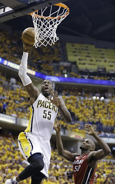 Indiana Pacers center Roy Hibbert (55) goes up for a shot against Miami Heat center Joel Anthony (50) during the second half of Game 6 of the NBA Eastern Conference basketball finals in Indianapolis, Saturday, June 1, 2013. (AP Photo/Michael Conroy)