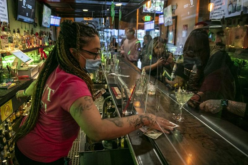 Covina, CA, Sunday, June 28,2020 - Bartender Christina Flintland serves drinks at Elvie's Public House. Governor Newsom orders bars to close as Covid-19 cases surge in California. (Robert Gauthier / Los Angeles Times)
