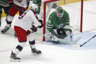 Columbus Blue Jackets left wing Stefan Matteau (23) shoots on Dallas Stars goaltender Jake Oettinger (29) during the first period during an NHL hockey game Thursday, April 15, 2021, in Dallas. (AP Photo/Richard W. Rodriguez)