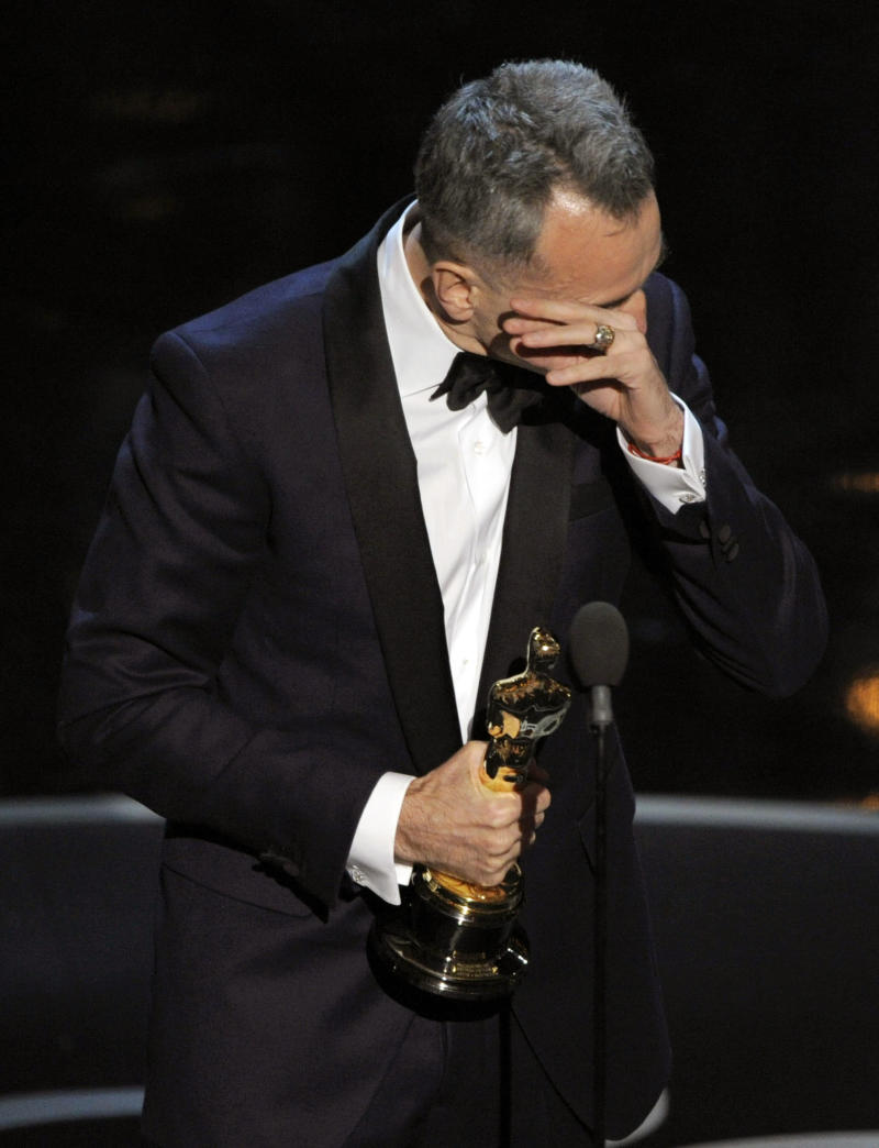 """Daniel Day-Lewis accepts the award for best actor in a leading role for """"Lincoln"""" during the Oscars at the Dolby Theatre on Sunday Feb. 24, 2013, in Los Angeles. (Photo by Chris Pizzello/Invision/AP)"""
