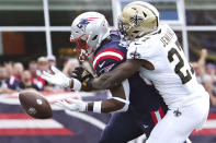 New Orleans Saints strong safety Malcolm Jenkins (27) breaks up a pass to New England Patriots tight end Jonnu Smith, left, during the first half of an NFL football game, Sunday, Sept. 26, 2021, in Foxborough, Mass. (AP Photo/Mary Schwalm)