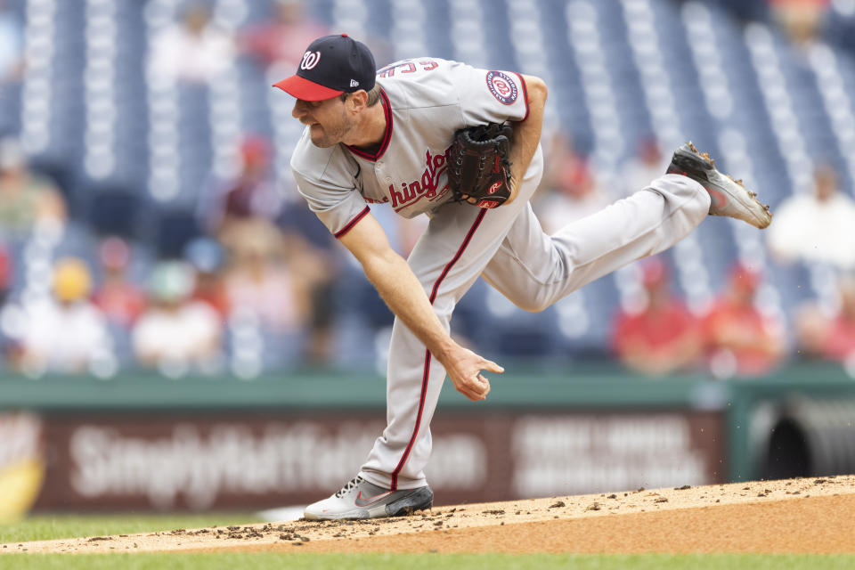 Washington Nationals starting pitcher Max Scherzer throws during the first inning of a baseball game against the Philadelphia Phillies, Thursday, July 29, 2021, in Philadelphia in the first game of a doubleheader. (AP Photo/Laurence Kesterson)