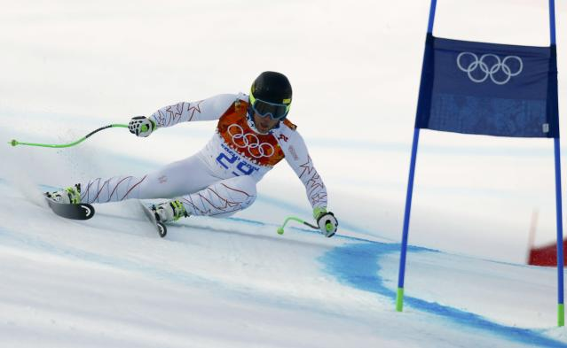 Andrew Weibrecht of the U.S. clears a gate during the men's alpine skiing Super-G competition at the 2014 Sochi Winter Olympics at the Rosa Khutor Alpine Center February 16, 2014. REUTERS/Ruben Sprich (RUSSIA - Tags: SPORT SKIING OLYMPICS)