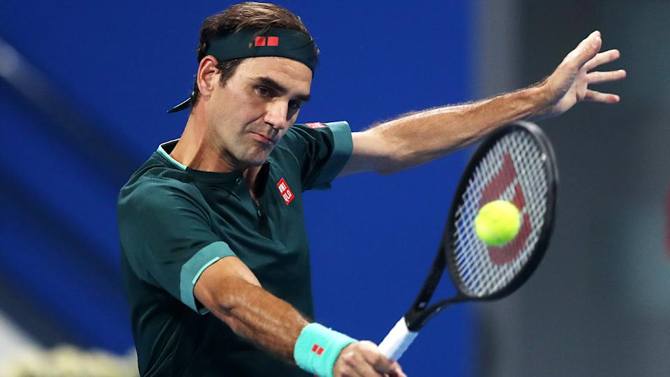 Roger Federer, pictured here hitting a backhand against Dan Evans at the Qatar Open.