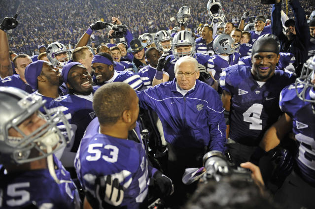 =MANHATTAN, KS - DECEMBER 01: Head coach Bill Snyder (C) of the Kansas State Wildcats walks off the field after defeating the Texas Longhorns for the Big 12 Championship on December 1, 2012 at Bill Snyder Family Stadium in Manhattan, Kansas. Kansas State defeated Texas 42-24. (Photo by Peter G. Aiken/Getty Images)