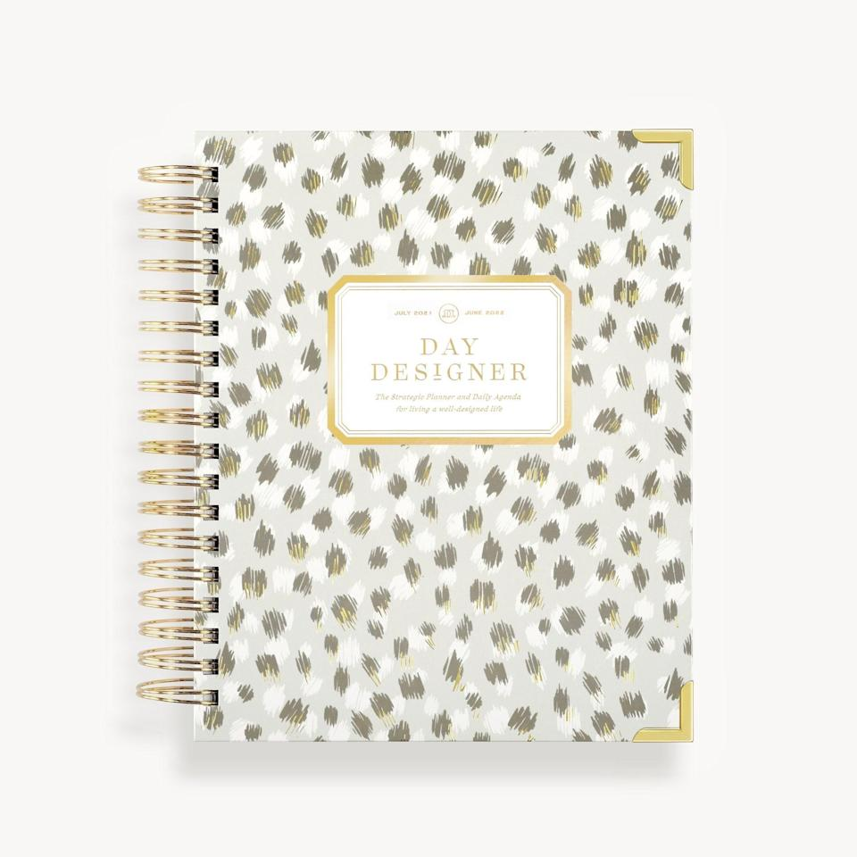 """Encourage your grad to take a much-needed breather before diving into life planning, but when they're ready to organize their thoughts and goals, equip them with the Day Designer Daily Planner. Broken out into daily and weekly layouts, they can map their upcoming interviews, Zoom meetings, to-do lists, or schedule coffee breaks with friends. The planner comes in a range of patterns, including this """"Chic"""" design."""