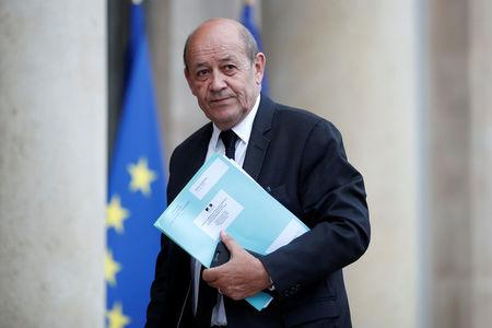 French Foreign Affairs Minister Jean-Yves Le Drian arrives at the Elysee Palace in Paris
