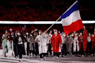 <p>France's flag bearers Clarisse Agbegnenou (L) and Samir Ait Said (C) lead their delegation as they parade during the opening ceremony of the Tokyo 2020 Olympic Games, at the Olympic Stadium, in Tokyo, on July 23, 2021. (Photo by Odd ANDERSEN / AFP) (Photo by ODD ANDERSEN/AFP via Getty Images)</p>