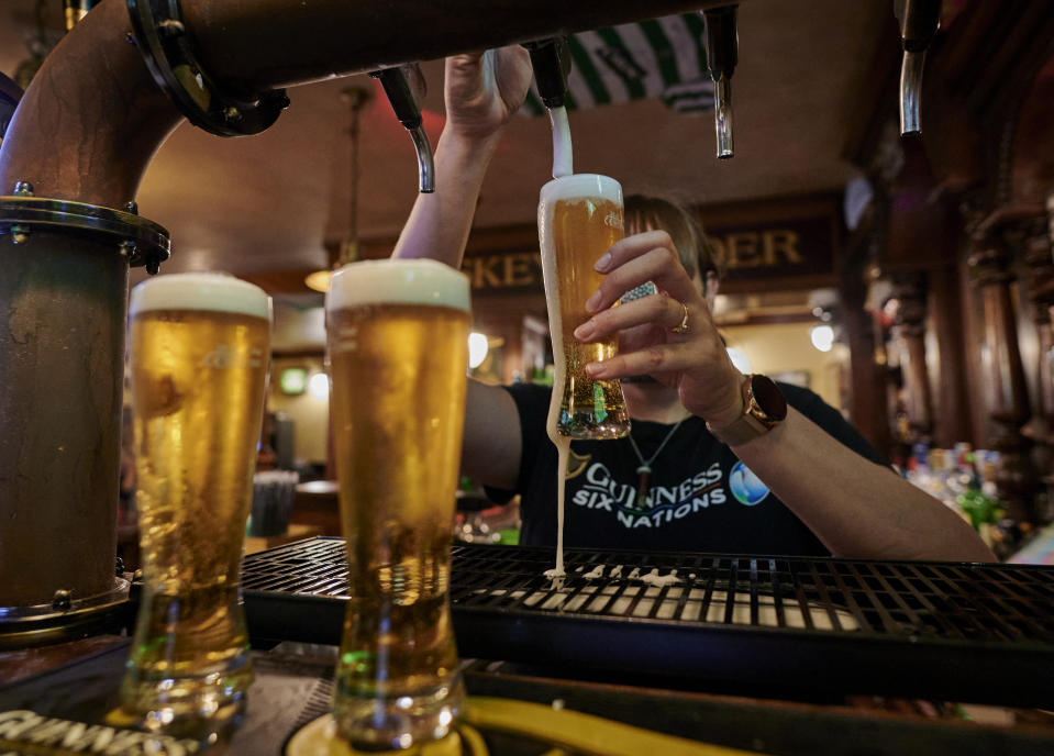 A bartender pours draught beers at a bar. Photo: Horacio Villalobos Corbis/Getty Images