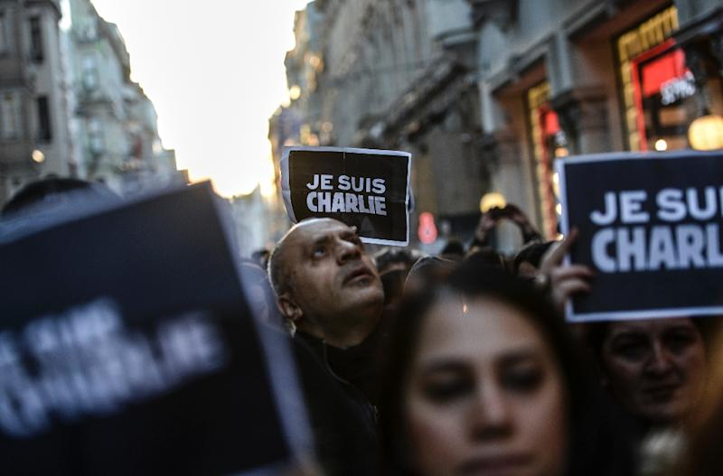"Turkish journalists hold posters reading ""Je suis Charlie"" (I am Charlie) during a 2015 rally in Istanbul, to show their support for French counterparts who were killed when Islamist gunmen stormed the offices of satirical weekly Charlie Hebdo (AFP Photo/Bulent Kilic)"