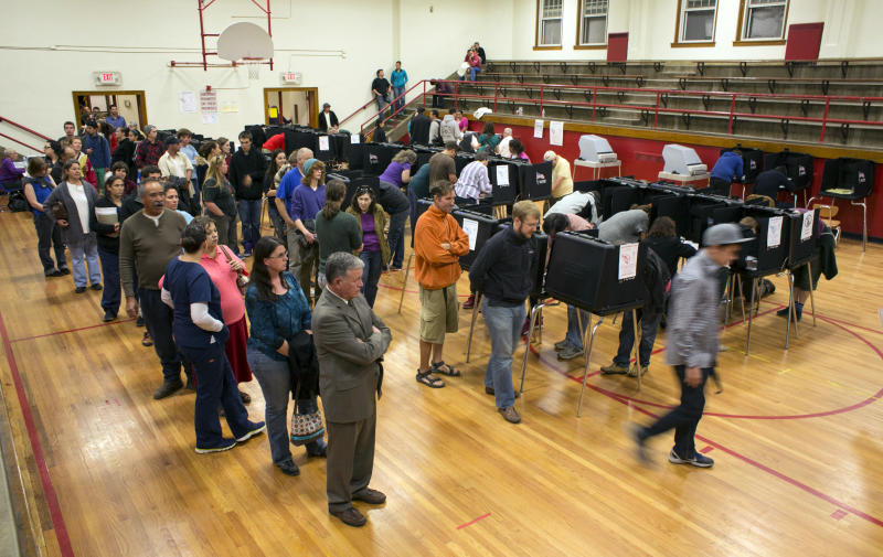 As the polls get set to close, voters wait in line to cast their ballots in the Jefferson Middle School gym, Tuesday, Nov. 6, 2012, in Albuquerque, N.M. (AP Photo/Jake Schoellkopf)
