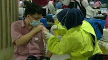 Market vendors get jabs as Indonesia enters second phase of vaccination