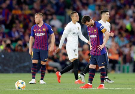 Soccer Football - Copa del Rey - Final - FC Barcelona v Valencia - Estadio Benito Villamarin, Seville, Spain - May 25, 2019 Barcelona's Lionel Messi looks dejected after Valencia score their second goal REUTERS/Marcelo del Pozo