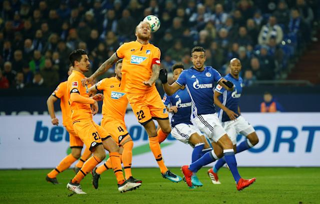Soccer Football - Bundesliga - Schalke 04 vs TSG 1899 Hoffenheim - Veltins-Arena, Gelsenkirchen, Germany - February 17, 2018 Hoffenheim's Kevin Vogt in action with Schalke's Franco Di Santo REUTERS/Leon Kuegeler DFL RULES TO LIMIT THE ONLINE USAGE DURING MATCH TIME TO 15 PICTURES PER GAME. IMAGE SEQUENCES TO SIMULATE VIDEO IS NOT ALLOWED AT ANY TIME. FOR FURTHER QUERIES PLEASE CONTACT DFL DIRECTLY AT + 49 69 650050