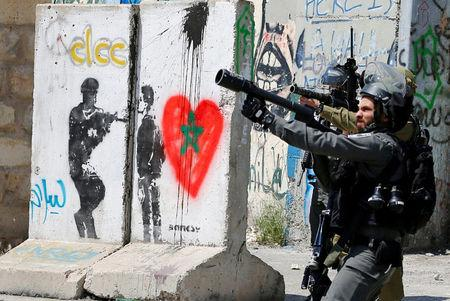 Israeli forces take position during clashes with Palestinian protesters following a protest in solidarity with Palestinian prisoners held by Israel, in the West Bank town of Bethlehem