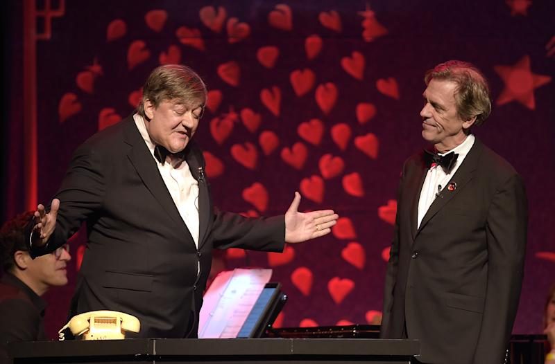 LONDON, ENGLAND - NOVEMBER 06: Stephen Fry (L) and Hugh Laurie reunite for Fry and Laurie performance on stage at the SeriousFun London Gala 2018 at The Roundhouse on November 6, 2018 in London, England. (Photo by Mike Marsland/Mike Marsland/Getty Images for SeriousFun)