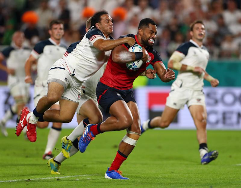 KOBE, JAPAN - SEPTEMBER 26: Joe Cokanasiga of England breaks past Mike Teo of USA before scoring his team's seventh try during the Rugby World Cup 2019 Group C game between England and USA at Kobe Misaki Stadium on September 26, 2019 in Kobe, Hyogo, Japan. (Photo by Francois Nel - World Rugby/World Rugby via Getty Images)