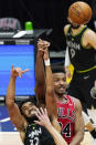 Minnesota Timberwolves center Karl-Anthony Towns, left, and Chicago Bulls center Wendell Carter Jr., battle for a rebound during the second half of an NBA basketball game in Chicago, Wednesday, Feb. 24, 2021. (AP Photo/Nam Y. Huh)