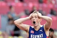 Norway's Karsten Warholm reacts after breaking the world record to win the men's 400m hurdles at the Tokyo Olympics