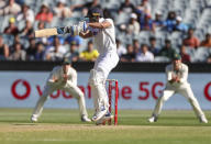 Indian batsman Shubman Gill hits the ball for four runs during play on day one of the Boxing Day cricket test between India and Australia at the Melbourne Cricket Ground, Melbourne, Australia, Saturday, Dec. 26, 2020. (AP Photo/Asanka Brendon Ratnayake)