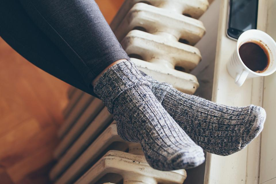 woman legs on radiator