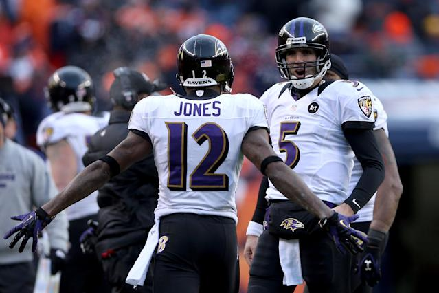 Baltimore Ravens QB Joe Flacco celebrates with Jacoby Jones against the Denver Broncos during the AFC divisional playoff game at Sports Authority Field at Mile High on Jan. 12, 2013 in Denver. (Jeff Gross/Getty Images)