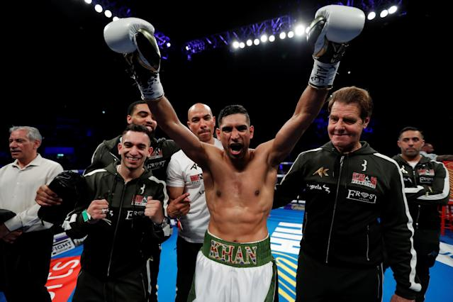 Boxing - Amir Khan v Phil Lo Greco - Echo Arena, Liverpool, Britain - April 21, 2018 Amir Khan celebrates with his trainer Joe Goossen and his team after winning the fight Action Images via Reuters/Andrew Couldridge