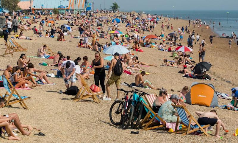 Visitors to Southend beach last week. There are concerns ahead of the bank holiday that people will ignore rules if they believe they are being flouted by government officials.
