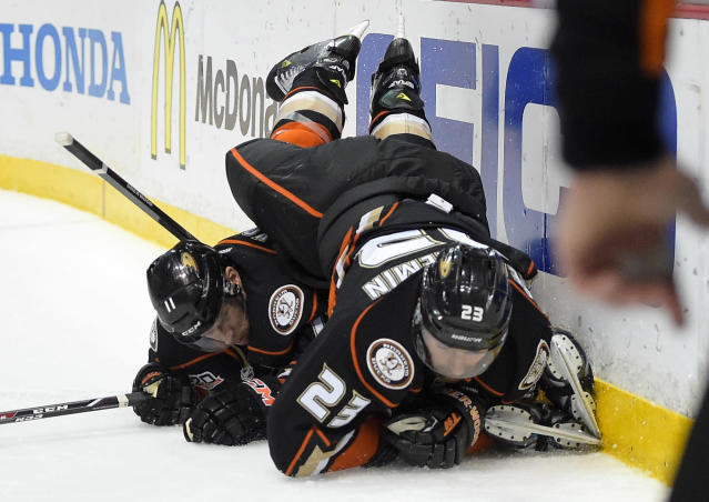 Anaheim Ducks defenseman Francois Beauchemin, right, falls over center Saku Koivu, of Finland, during the first period in Game 2 of an NHL hockey second-round Stanley Cup playoff series against the Los Angeles Kings, Monday, May 5, 2014, in Anaheim, Calif. (AP Photo/Mark J. Terrill)