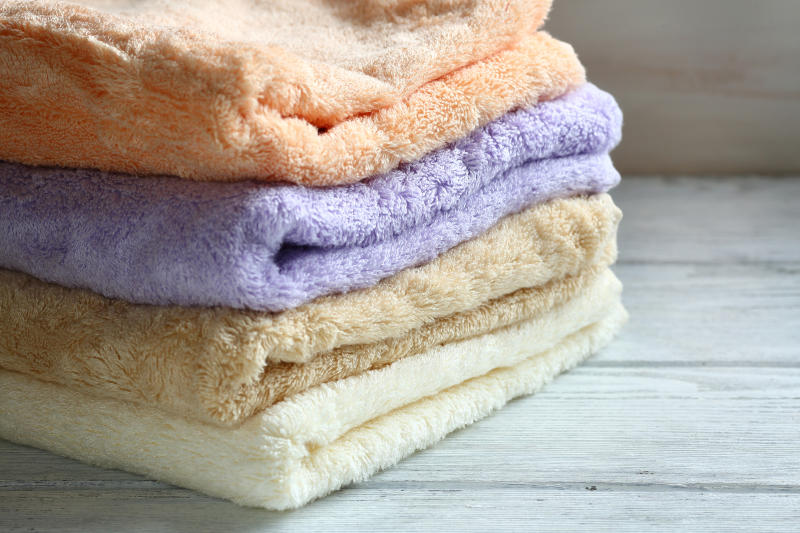 A stack of folded multicolored towels.
