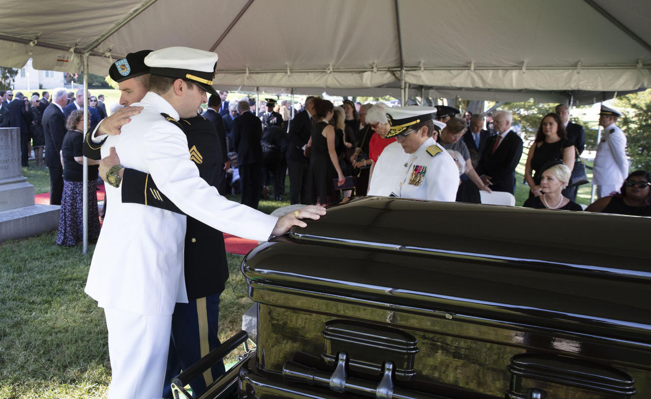 <p>In this image provided by the family of John McCain, Jimmy McCain hugs his brother Jack McCain, touching casket, as Cindy McCain, watches during a burial service for Sen. John McCain, R-Ariz., at the cemetery at the United States Naval Academy in Annapolis, Md., Sunday, Sept. 2, 2018 (Photo: David Hume Kennerly/McCain Family via AP) </p>