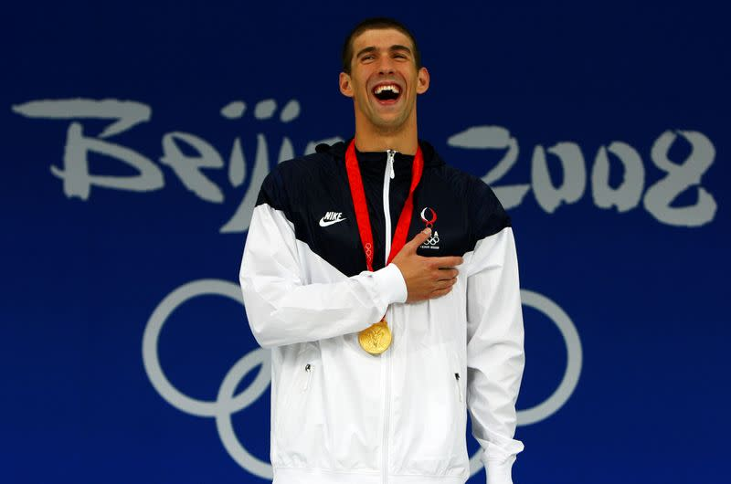 FILE PHOTO: Michael Phelps of the U.S. smiles during the medal presentation ceremony at the Beijing 2008 Olympic Games