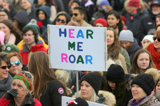 A demonstrator holds a sign saying 'Hear Me Roar' as hundreds take part in the Women's March in downtown Toronto on Jan. 20, 2018.