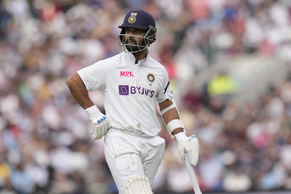 India's Ajinkya Rahane walks off the pitch after being given out cough by England's Moeen Ali off the bowling of England's Craig Overton the first day of the 4th cricket Test between England and India at The Oval cricket ground in London, Thursday, Sept. 2, 2021. (AP Photo/Kirsty Wigglesworth)