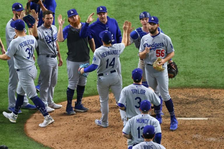The Los Angeles Dodgers celebrate their 15-3 victory over the Atlanta Braves in game three of baseball's National League Championship Series