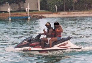 Nevin Shapiro and a second source said this photo of Leon Williams (holding up two fingers), and the mother of D.J. Williams (identity redacted by Yahoo! Sports) was taken during an outing on the booster's yacht in the summer of 2003.