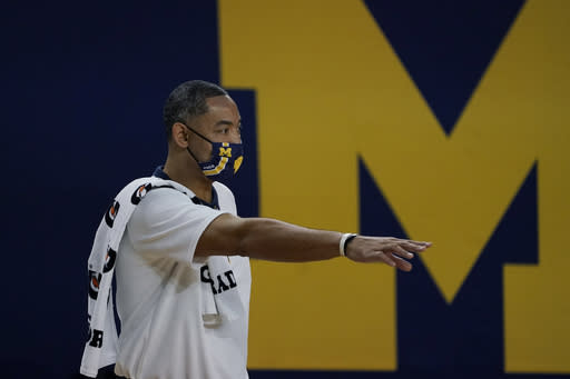 Michigan head coach Juwan Howard gestures from the sideline during the first half of an NCAA college basketball game against Bowling Green, Wednesday, Nov. 25, 2020, in Ann Arbor, Mich. (AP Photo/Carlos Osorio)