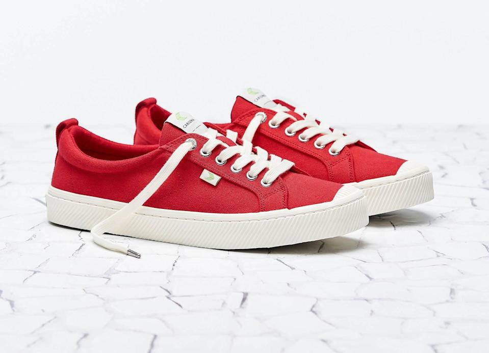 """<p>""""I'm a <a href=""""https://www.popsugar.com/fashion/photo-gallery/48221532/image/48221555/Cariuma-Off-White-Canvas-Sneaker"""" class=""""link rapid-noclick-resp"""" rel=""""nofollow noopener"""" target=""""_blank"""" data-ylk=""""slk:big fan of Cariumas"""">big fan of Cariumas</a>. Huge. These sustainable and stylish <span>OCA Low Red Canvas Sneakers</span> ($79) utilize raw materials and come equipped with a vegan insole that renders them comfortable enough for all-day wear. Even the box is recycled and recyclable."""" - CS</p>"""